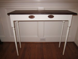 Console Table - { antiqued-white painted base with walnut stained table top}  Handmade and donated by Roger Callahan of the Charlotte Woodworkers Association.